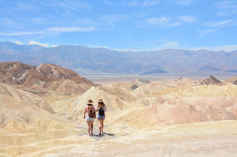 Girls hiking in the mountains desert.