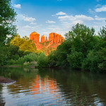 Beautiful Cathedral Rock reflected in water. Oak Creek at Red Rock Crossing, Crescent Moon Picnic, Sedona, Arizona, USA.