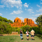 Family on hiking trip enjoying view of  Cathedral Rock  at Red Rock Crossing, Crescent Moon Picnic, Sedona, Arizona, USA