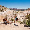 Girls relaxing and  enjoying beautiful view on hiking trip in the mountains. Kasha-Katuwe Tent Rocks National Monument, Close to of Santa Fe, New Mexico, USA