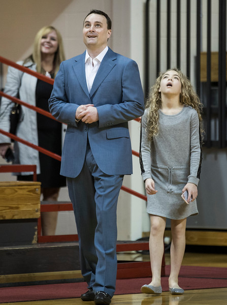 Archie Miller and his daughter react while walk onto the Assembly Hall court for the first time as Head Coach. The arena was empty and his name was on the big screen welcoming him to Indiana.