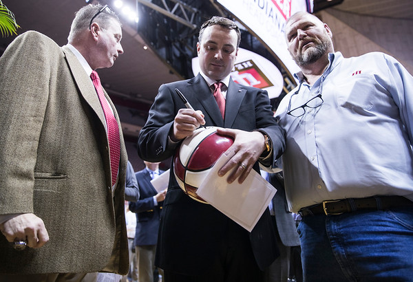 Archie Miller signs his first basketball as Head Coach of Indiana after speaking at the press conference revealing him as coach.