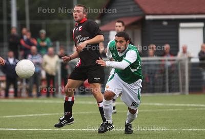 ARC-voetballer Christan Cabrera Ortega (r) tijdens oefenwedstrijd tegen HBS - DEN HAAG 25 JULI 2011 - FOTO NICO SCHOUTEN