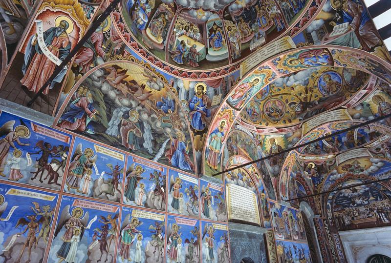 Fresco narrative mural paintings in the colonnade surrounding the church at Rila Monastery aka Monastery of Saint John of Rila in valley of Rilska River, Rila Mountains, Bulgaria