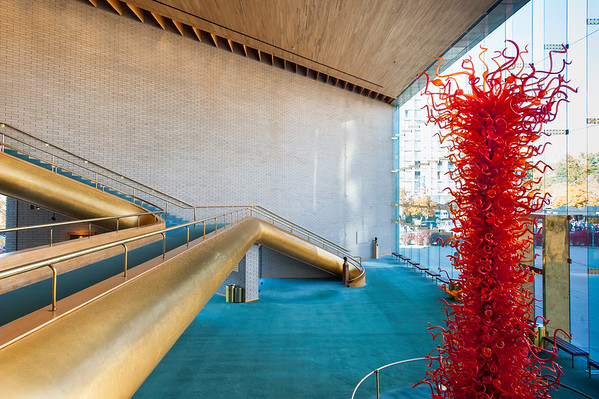 """Abravanel Hall - view into main public gallery with red glass sculpture  """"The Olympic Tower"""" by Dale Chihuly"""
