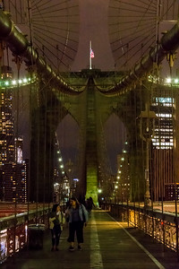 Walking across the Brooklyn Bridge at night