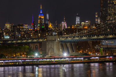 East River and the Empire State Building at night
