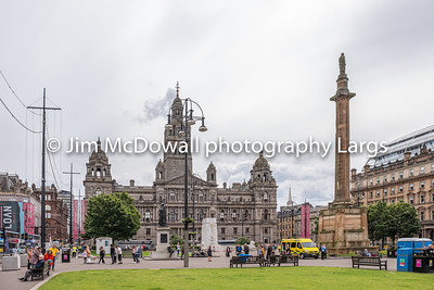 Impressive Architecture Looking over George Square Glasgow to the famous City Council Buildings on a busy day in Glasgow