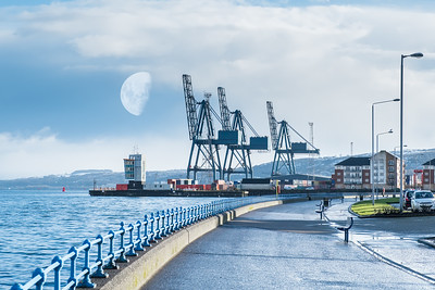 Greenock Esplanade to Ocean Terninal Docks Early Morning with Half Moon above the Cranes and Snow on the Greenock Hills