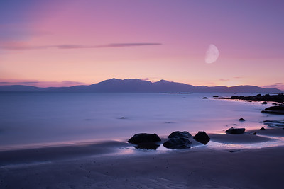 The Arran Mountains at Sunrise on a Freezing cold Morning with a faint Moon on a Dramatic Pink Sky
