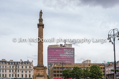 Impressive architecture looking over George Square in Glasgow with the 'People Make Glasgow' Statement on a busy Saturday Afternoon in Glasgow city centre.