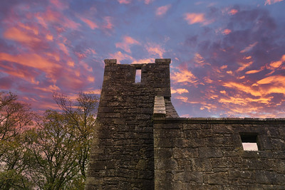 The Old Semple Ruins at sunset with blazing red sky in Renfrewshire Scotland