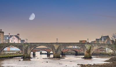 The Old Brigg Looking down the River early in the Morning in Ayr Scotland