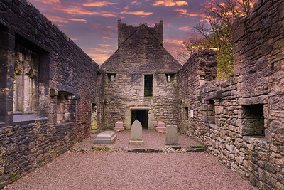 Inside the Old  Semple Ruins at sunset with blazing red sky in Renfrewshire Scotland