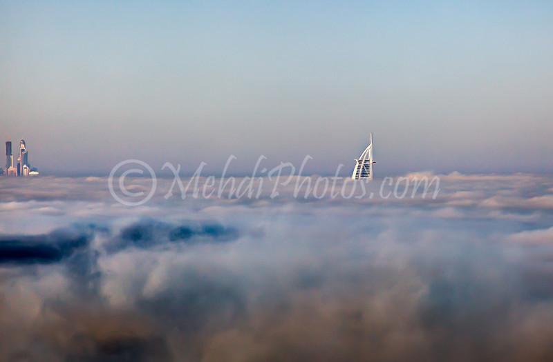 Fog has covered all Dubai. In the distance part of Dubai Marina and Burj Al Arab can be seen.
