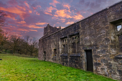 Side Elevation of the Old Semple Ruins at sunset with blazing red sky in Renfrewshire Scotland