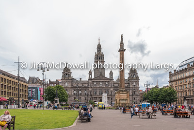 Impressive Architecture Looking over George Square Glasgow to the famous City of Glasgow Council Buildings on a busy day in Glasgow