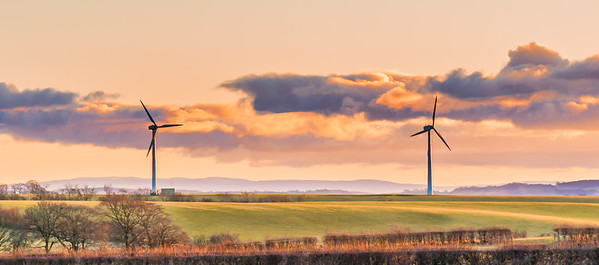 Two Wind Turbines on a cold Scottish Day in Autumn at Sunset with a  dramatic evening sky