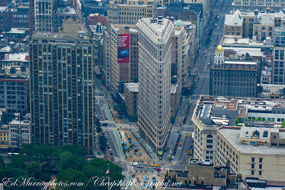 Flatiron: New York City's 285 foot tall Flatiron Building. Completed in 1902, the Flatiron Building's unique shape is attributed to the triangular island formed from 5th ave, 22nd and 23rd Streets.