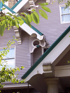 1640 SE Holly Street - Showing detailed view of rafter tails and porch supports.