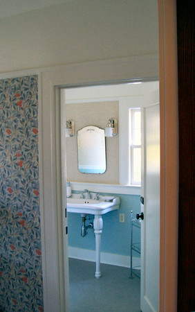 The original bathroom had been alterer beyond restoration, and was a great deal larger than required for the offices.  The new bath, however, employs period style fixtures and details.