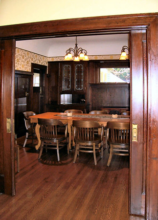 The richly appointed dining room has become the main conference room for the organization.  The built-in china cabinets and buffets have been restored, and feature their original hardware.
