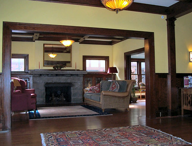 Like all Craftsman Style homes, this one features broad vistas through the main floor, with wide entrances between the rooms, as seen here in the view from the entry hall into the living room.