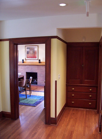 The original master bedroom is now the office of the Executive Director.  The original linen cabinets are at the right.  The brick fireplace with its original Craftsman Style mantel in the master bedroom has been completely restored.