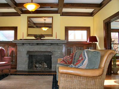 Another view of the fully restored stone fireplace in the living room.