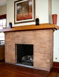"This detail view of the master bedroom fireplace shows the fine ""egg and dart"" detailing just under the mantel.  Now fully restored, it has been equiped for gas burning."
