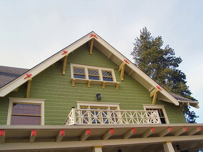 Faber was not the only designer of the period to use pegged tenons on the barge board (highlighted in orange paint), but they are especially effective in this house where the gable ends appear on all four sides.