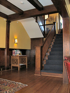 Another view of the main entry and stairs.  Box beams ornament much of the first floor ceilings.