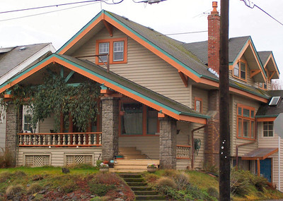 2205 SE 34th Ave - This house stands across the street from Faber's own house (see 2204 SE 34th).  It is attributed to Faber based on the stone porch pillars and the distinctive 3 rayed timber support under the porch gable, which appears in several known Faber designs.  The assymetrical porch roof is also an indication of a possible Faber design.