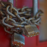 chain and locks on doors of closed business