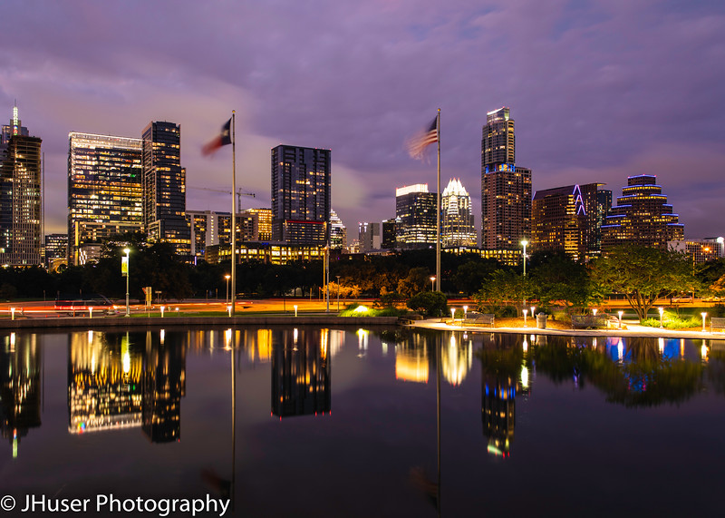 Reflections of the city skyline at night in Austin Texas