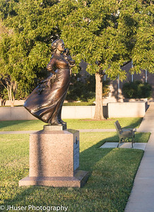 Texas pioneer woman statue on the Capitol grounds in the morning light