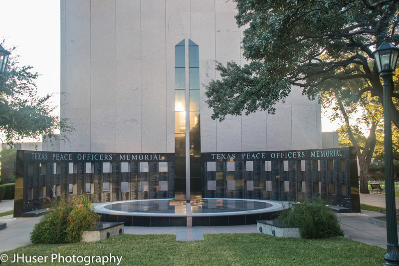 Texas Peace Officer Memorial reflecting morning light