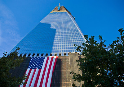 NEW YORK - OCTOBER 6: A view of the Freedom Tower from the 9/11 Memorial still under construction on October 6, 2011.