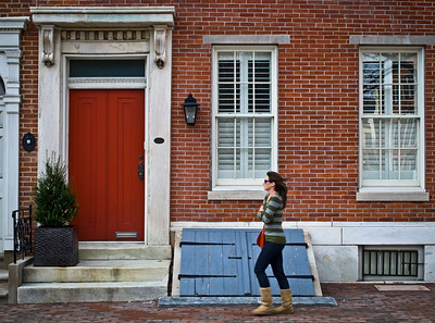 "A girl walks past the historic home in ""Society Hill"" Philadelphia."