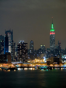 """Holiday Colors""  The Empire State Building at night with red and green lights during the Christmas season."