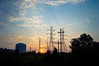 """Electrical Tower Sunrise""  A view of the electrical towers and industrial storage tanks at sunrise in Sayerville NJ."