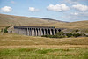 Freight train crossing the Ribblehead viaduct, North Yorkshire, England, UK , on the Settle-Carlisle railway line