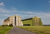Airship hangars at Cardington, Bedfordshire.  The first was built in 1915 and the second was added in 1928.  Since then they have had a chequered history and fell into disrepair at one stage but Hangar 2 has now been restored while work is underway to restore Hangar 1.