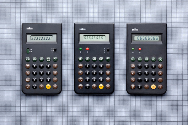 """Three Braun calculators, ET33, ET55 and ET66, designed by Dieter Rams and Dietrich Lubs, 1977 - 1987. A classic of minimalist design and a look that was heavily """"borrowed"""" by the designers of the iPhone."""