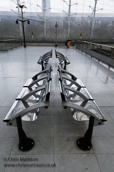 Stainless steel seating at the TGV railway station Charles De Gaulle International Airport. Designer unknown.