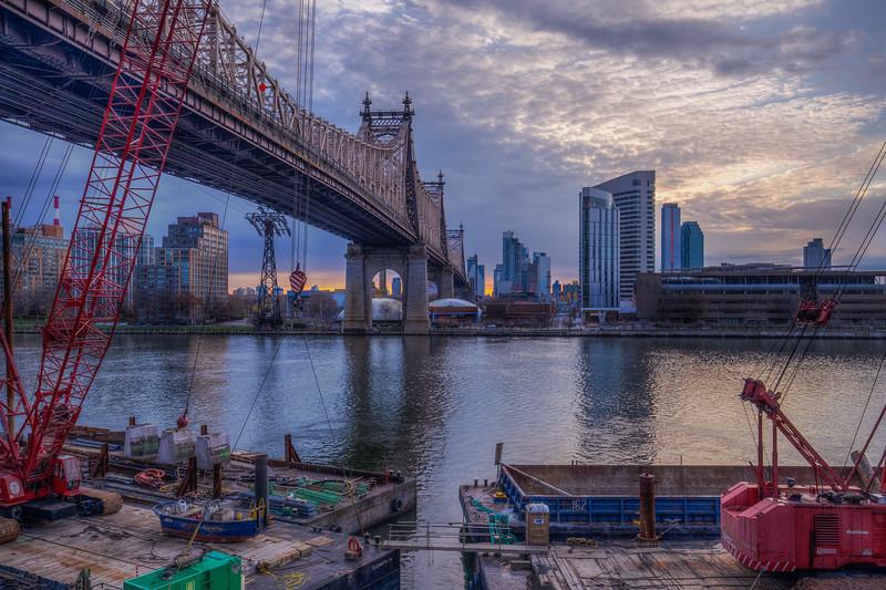 59th Street Bridge With Red Cranes