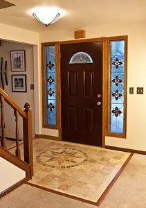 Travertine Tile Entry, Custom Handmade Stain Glass Side Lights.