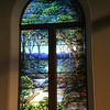 Landscape window  Based on the opening verse of Psalm 42.  The depth of the scene and the beautiful blues are tranquil and calming.  The two landscape windows are on the front sides of the sanctuary where most of the congregation are able to see them throughout the church service.