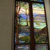 Landscape Window depicting Psalm 23.  Tiffany's Favrile glass has a rough or uneven surface.  We were invited to touch the sheep to feel their wool like texture.