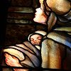 "A closeup of a Mother with her small child as she gazes upon Christ in the ""Christ Blessing the Children"" window."